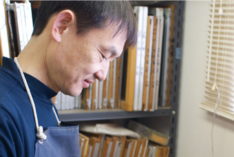 CEO Yasuhiro Saura, working in the studio
